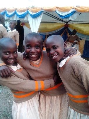 Anna, Winie and Babra smart in school uniforms