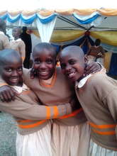 Anna, Winie and Babra smart in school uniforms