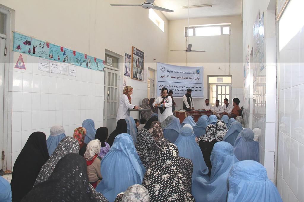 Doctor examining patient in Herat clinic