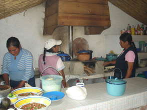 Cooking with the women in the community
