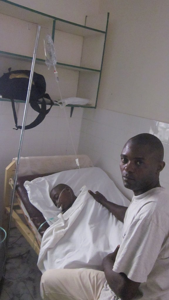 Ruphat with his father after his last surgery