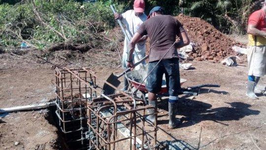 Community members working on the bridge3