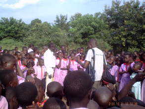 Moses engages kids and teachers at Kiwolera Army