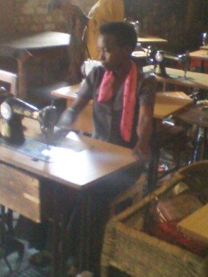 girl studing to sew cloths(dresses,shirt..)