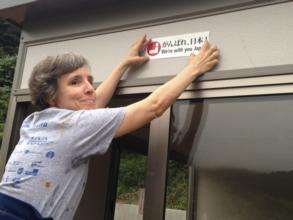 Volunteer Diane Olsen helps with construction
