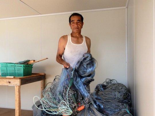 Ryuoichi Oikawa prepares salmon nets in new shed