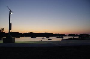 The Isatomae port light at night