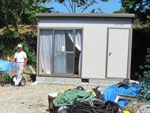 Carpenter Takeshi Shimonishi inspects fishing shed