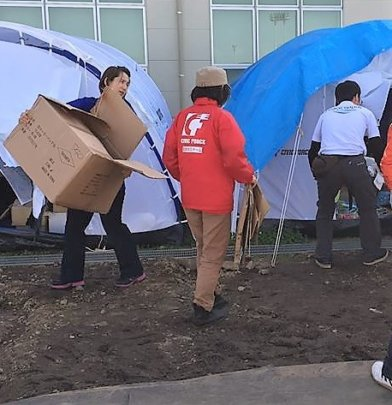 Helping evacuees move to government housing.