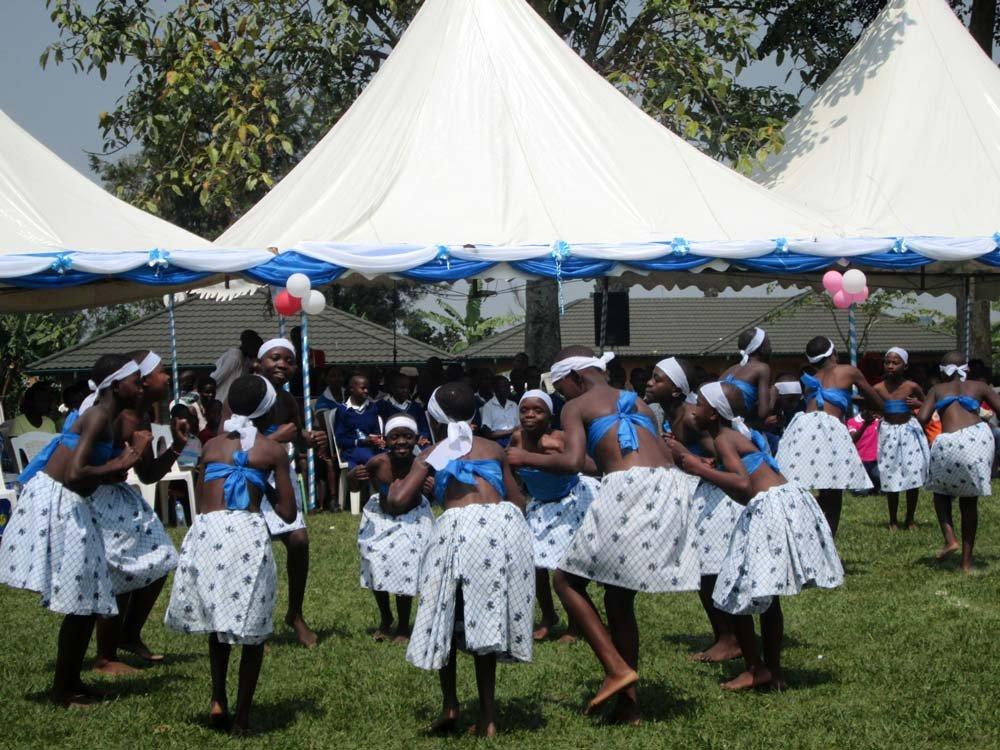 Children dance and celebrate anniversary.