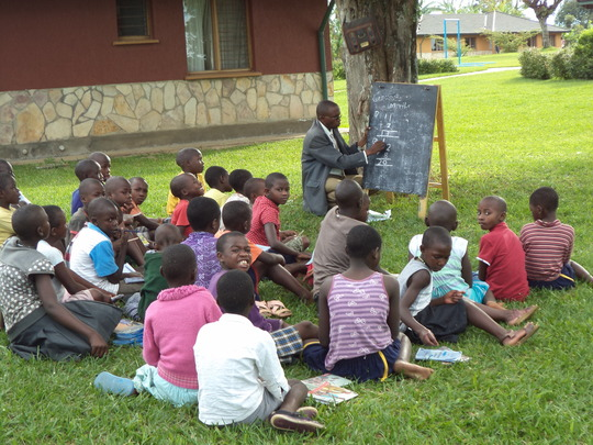 Remedial lessons in progress at the village.