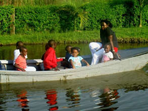 A family enjoys a boat ride during an outing