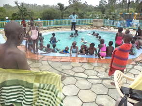 Children enjoy a splash in the cool water