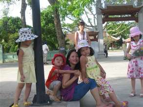Ms. Thuy, IMCRA staffer, with youngsters in Hanoi