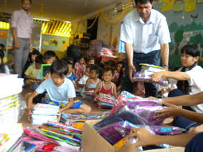 Presenting School Supplies to Children