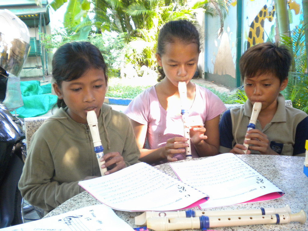 Children in their recorder lesson (Children Club)