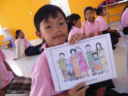 A boy showing his coloring picture