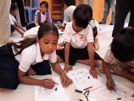 Children drawing at children clubs