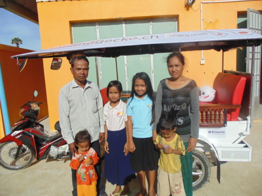 Smiling children with their family