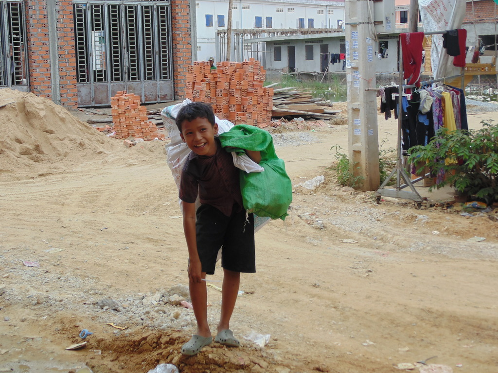 Children working as recycle trash collectors...