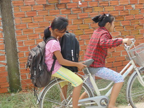Children riding home with school supplies.