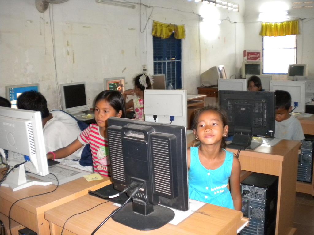 Children in computer lesson (Children Clubs)