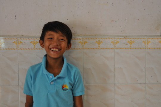 A boy smiling with hope