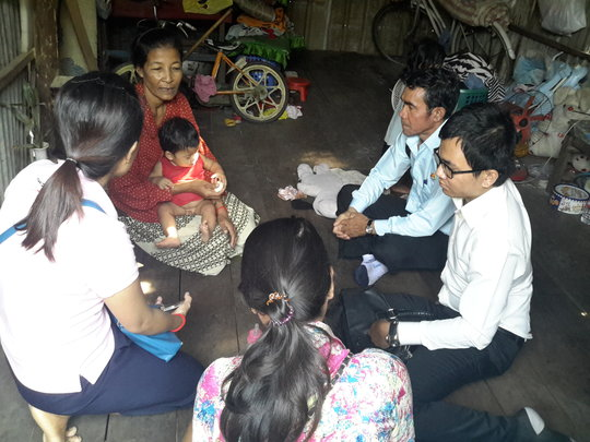 Our staff with Government officers visit families