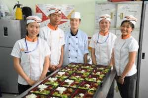 KOI Bento cook and students