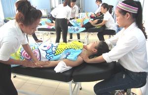Students practice body massage