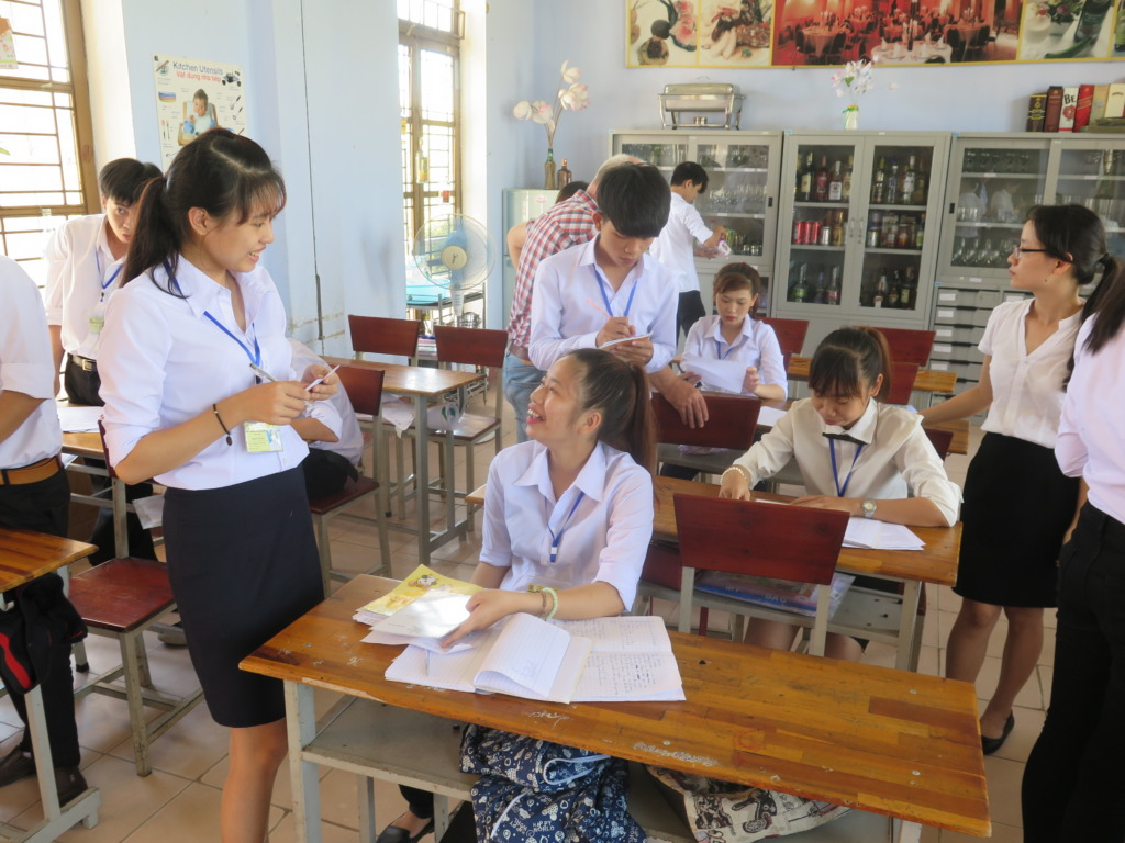 REACH Hue F&B students practice taking orders
