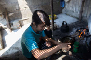Thuyet prepares meal at home