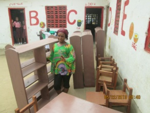 Deki's proprietor helps prepare the reading room