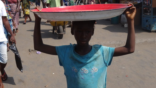 A child selling to help support her family