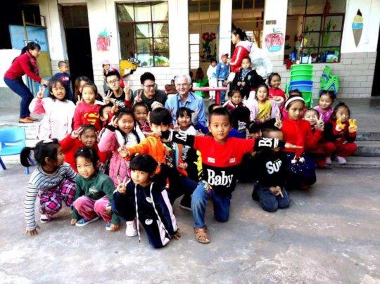 Volunteer Cardiologist Julio and School Children