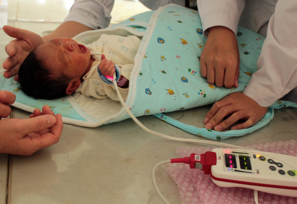 Baby being checked for newborn heart disease.
