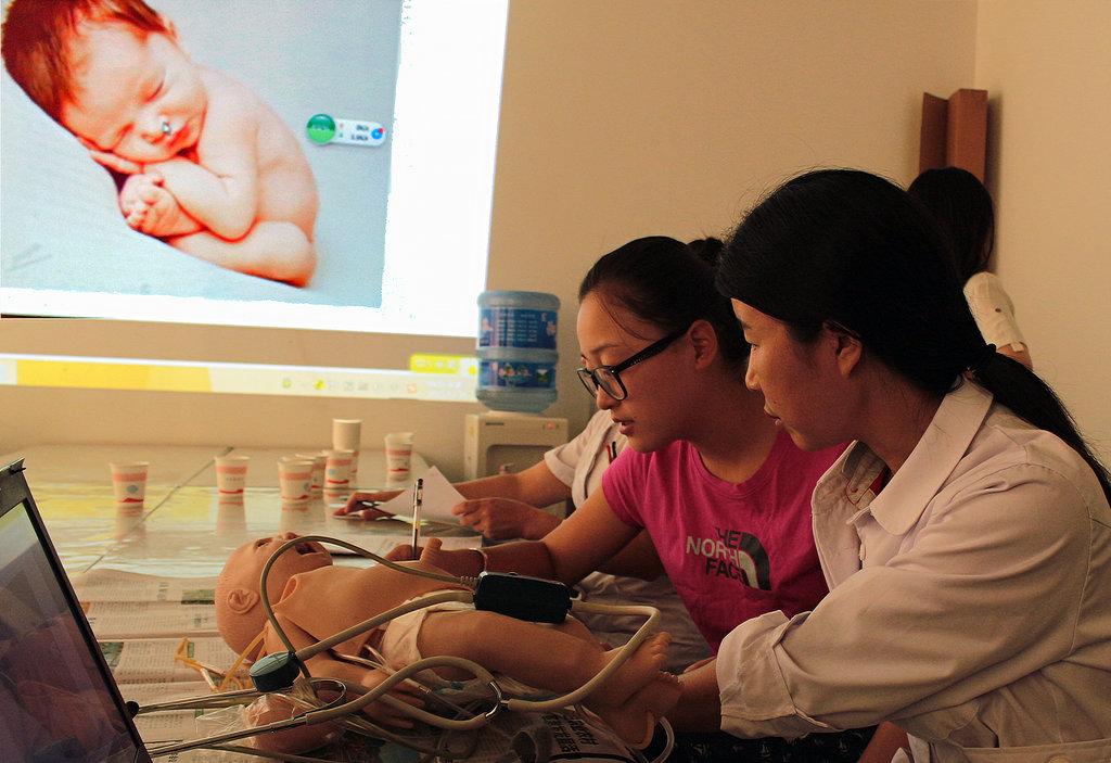 China Cal trainer teaches how to screen newborns.