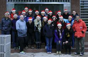 Our team wearing Santa hats