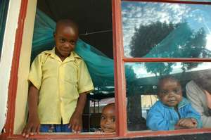 Good looking kids in window at Nyakibale