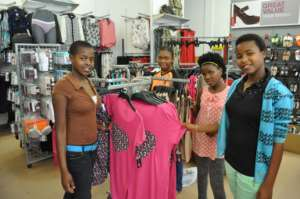 Teen girls shopping for much needed clothing