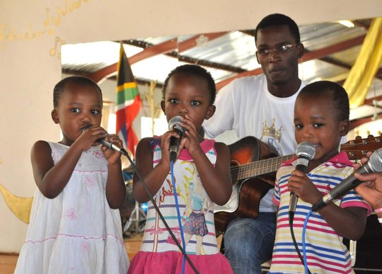 Our own triplets singing for the gathering