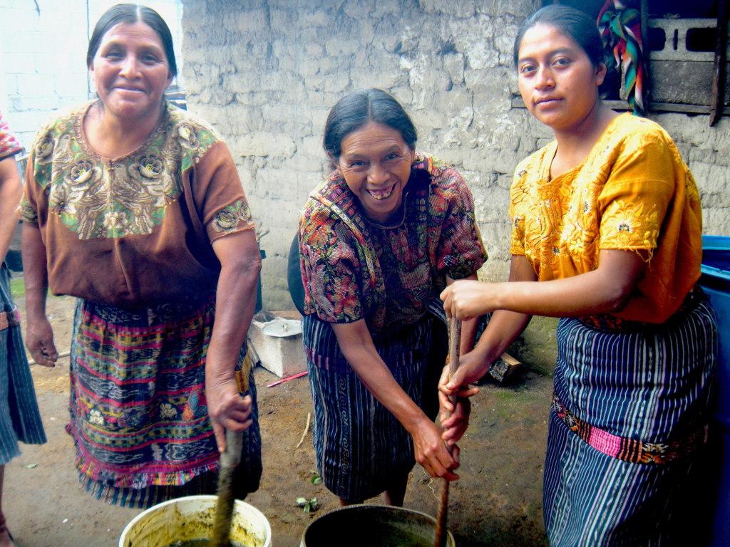 Candelaria, Manuela, Josefa stir their substances