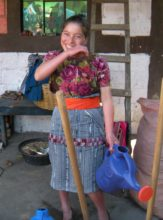 Maria with her new gardening tools.