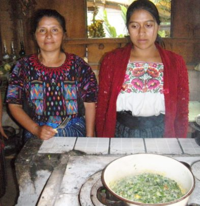 The women learn how to mix the ingredients