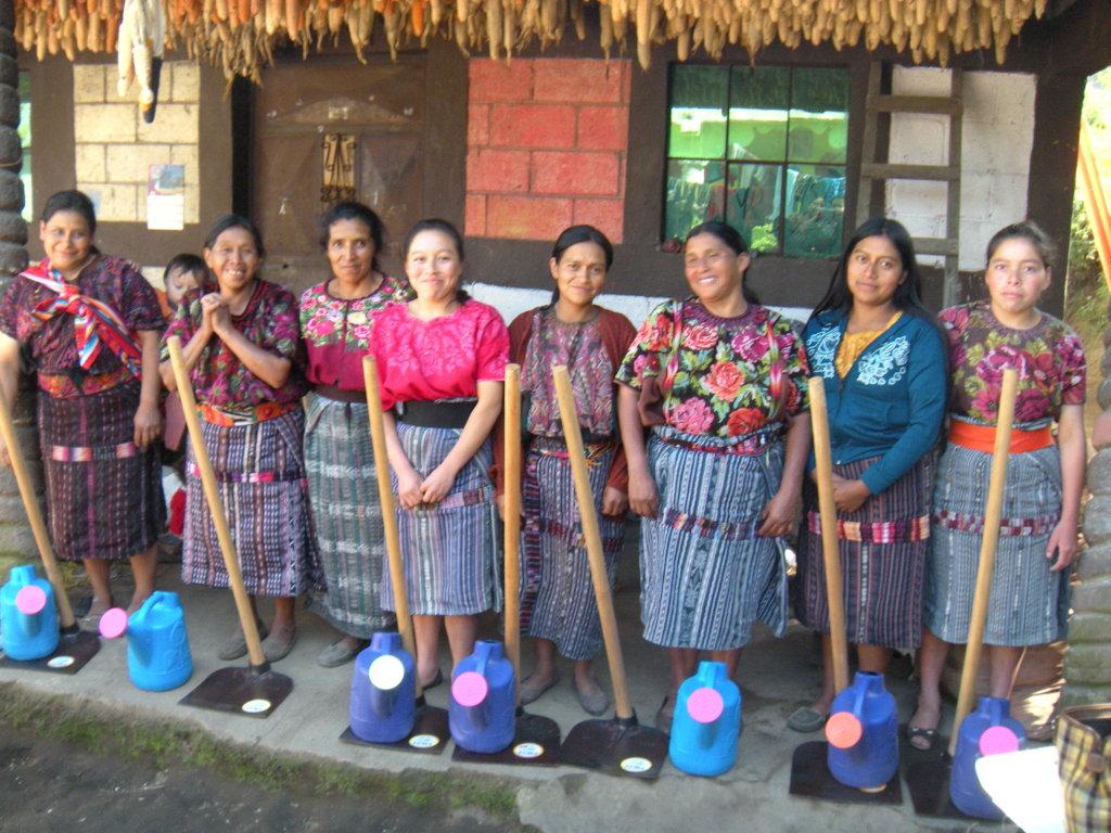Josefa (in blue) distributes tools to new members