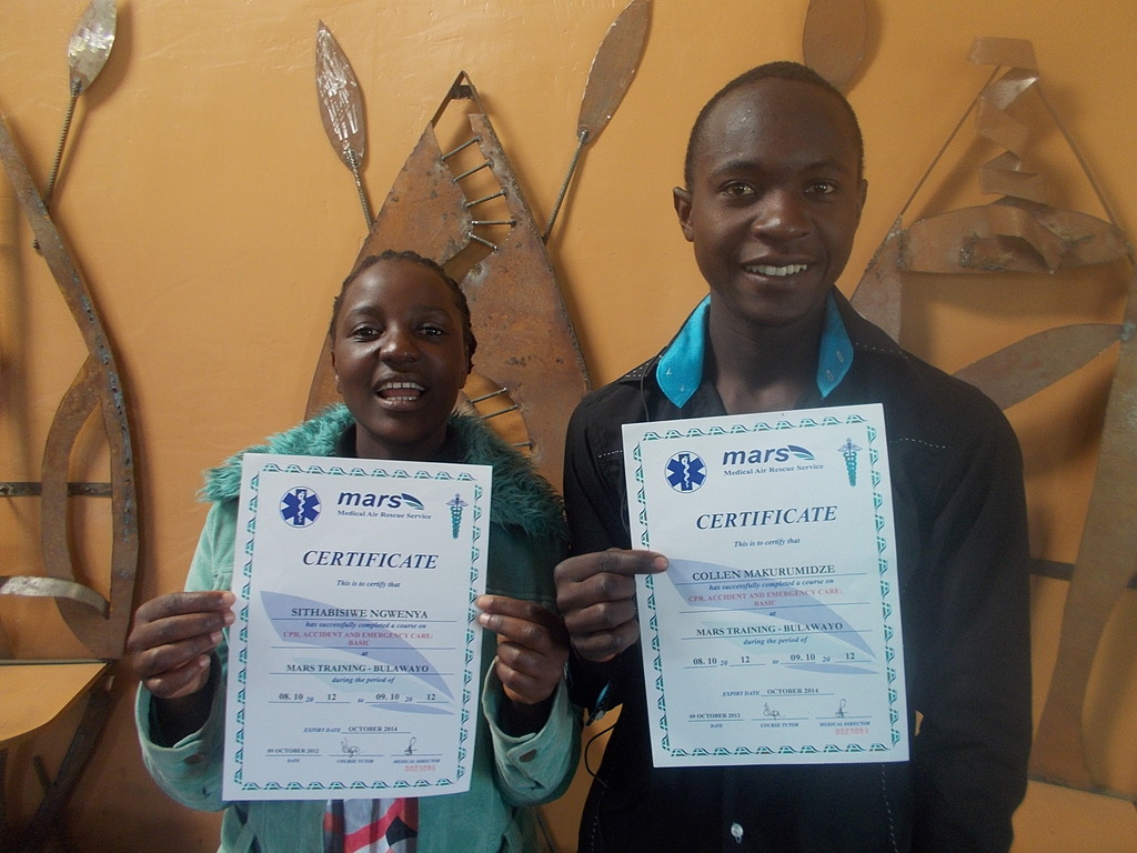 Sithabisiwe and Collen with first aid certificates
