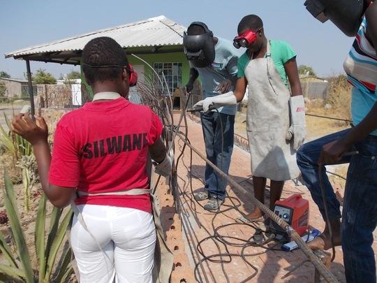 Girls welding railing