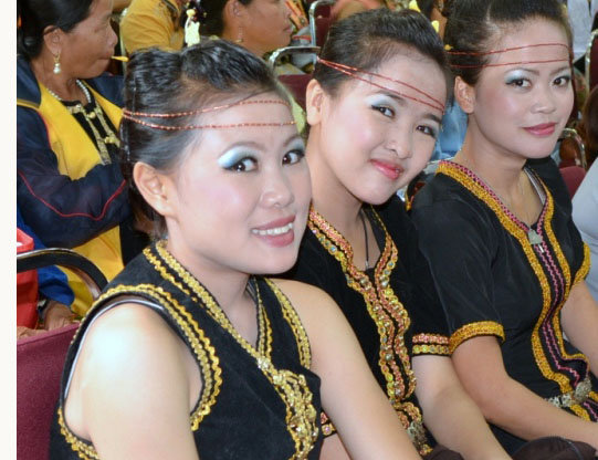 Young Dusun girls in traditional costumes