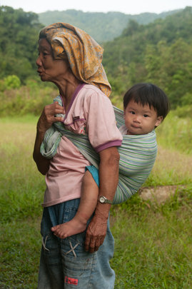 A child from Ulu Papar with her grandmother
