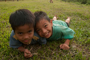 Kids from Ulu Papar playing on the grass